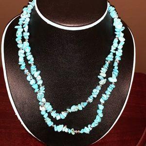 Woman's necklace turquoise color gems